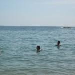 Claudia, Milena, and Walter taking a swim.