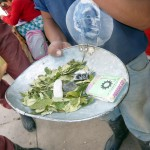 Buying coca leaves for the miners.