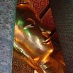 Face of the 46m long reclining Buddha at Wat Pho.