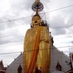 The 32 meter tall standing Buddha at Wat Indrawihan.
